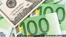 Купюры в долларах и евро