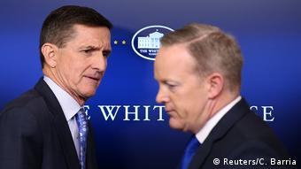 Ex-National security adviser General Michael Flynn (L) next to Press Secretary Sean Spicer at the White House in Washington February 1.