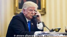 28.01.2017 *** President Donald Trump speaks on the phone with Prime Minister of Australia, Malcolm Turnbull in the Oval Office on January 28, 2017 in Washington, DC, The call was one of five calls with foreign leaders scheduled for Saturday. Photo by Pete Marovich/UPI Photo via Newscom picture alliance |