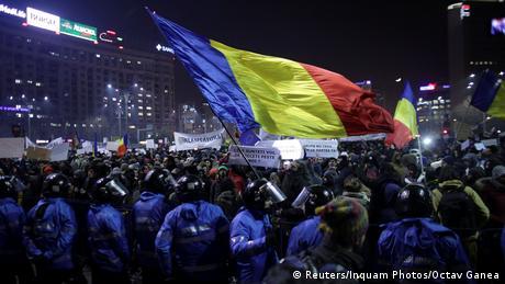 Protestors wave flags