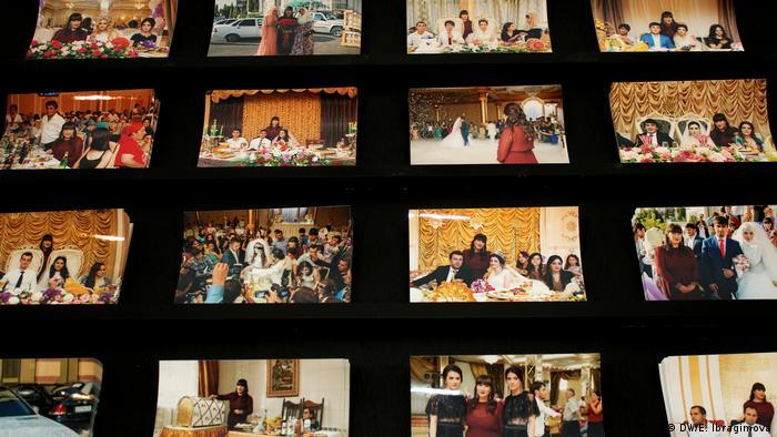 many photos on a black wall