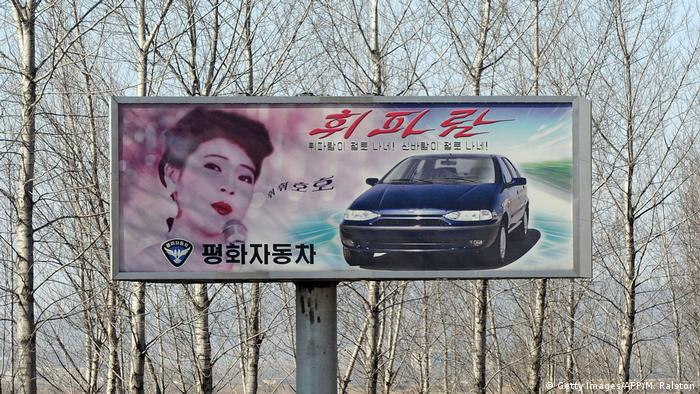 An advertising billboard promoting the North Korean made Pyeonghwa brand car is pictured outside the North Korea capital Pyongyang