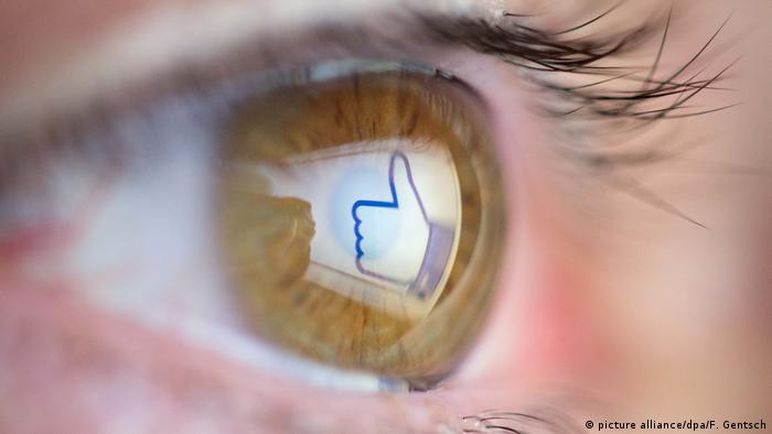 Facebook thumbs up in an eye