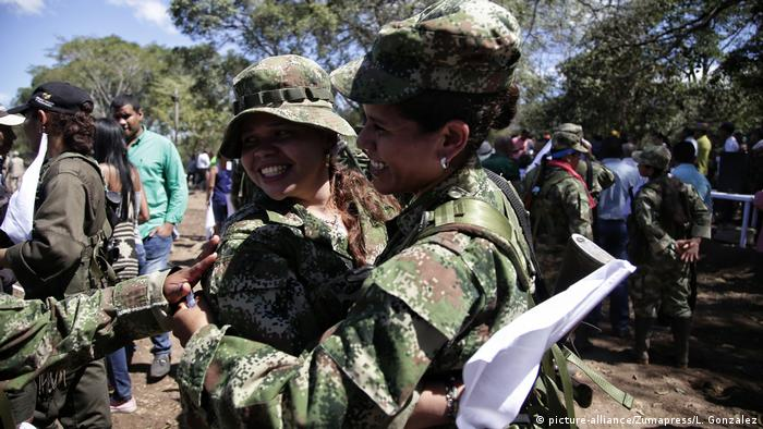 FARC rebels hug each other at a UN-monitored peace zone