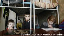 The Shevchenkos children play in a hostel room after being evacuated from their home on the outskirts of Donetsk that was constantly shelled, in Ukraine, Thursday, Feb. 2, 2017. In the rebel stronghold of Donetsk, the self-proclaimed authorities said two civilians were injured Wednesday evening when projectiles hit their houses in Donetsk's north. (AP Photo/Alexander Ermochenko) |