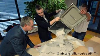 Ballots being emptied onto a table for counting