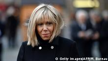 Brigitte Trogneux, the wife of Former French Economy Minister Emmanuel Macron, leaves the Saint-Sulpice church after attending a service for the funeral of French businessman Henry Hermand, on November 10, 2016 in Paris. / AFP / MARTIN BUREAU (Photo credit should read MARTIN BUREAU/AFP/Getty Images)