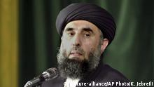 ARCHIV 2001 *** In this Wednesday, Oct. 3, 2001 file photo, Gulbuddin Hekmatyar, the leader of Afghanistan's Hezb-i-Islami speaks at the Tehran University in Iran. The only insurgent leader to sign a peace pact with Afghanistan's government will return to the country within weeks, his chief negotiator says, in a move that could shake up Afghan politics and complicate the much wider war against the Taliban. Hekmatyar, a former warlord who battled U.S. forces after the 2001 invasion and nursed a bitter rivalry with other Afghan factions, agreed to lay down arms last year. (AP Photo/Kamran Jebreili, File) |