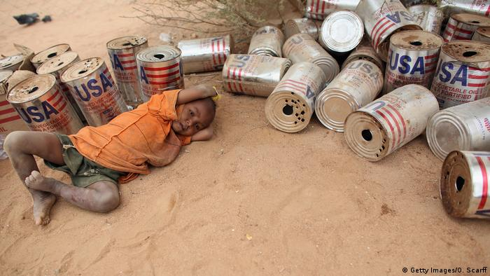 A child lying on the ground in Dadaab refugee camp in Kenya