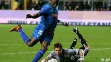 Hoffenheim's Chinedu Obasi, left, scores the third goal for his team against Hamburg's goal keeper Frank Rost during a German first division soccer match between TSG 1899 Hoffenheim and Hamburger SV in Mannheim, central Germany, Sunday, Oct.26, 2008. (AP Photo/Michael Probst)** NO MOBILE USE UNTIL 2 HOURS AFTER THE MATCH, WEBSITE USERS ARE OBLIGED TO COMPLY WITH DFL-RESTRICTIONS, SEE INSTRUCTIONS FOR DETAILS **