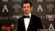 Raul Arevalo, who won the Best New Director award, holds his trophy during the Spanish Film Academy's Goya Awards ceremony in Madrid, Spain, February 4, 2017. REUTERS/Juan Medina