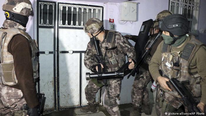 Turkish anti-terrorism police break down the door to a property