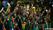 Cameroon celebrate with the trophy after winning the African Cup of Nations