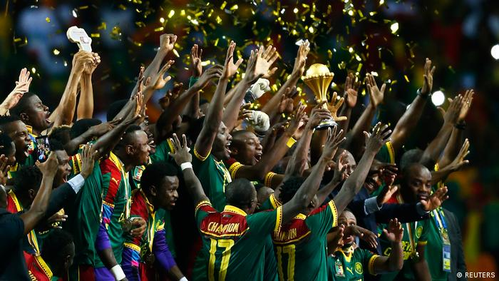 Cameroon celebrate with the trophy after winning the African Cup of Nations (REUTERS)