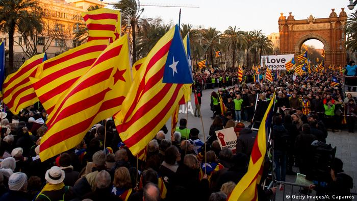 Supporters protest as trial of Catalan leader begins