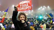 06.02.2017+++ A woman holds up a sign that reads ' government without corruption' during a demonstration of thousands of Romanians against their government in Bucharest, Romania, February 6, 2017. REUTERS/Stoyan Nenov