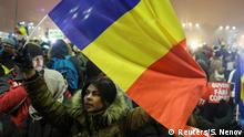 06.02.2017+++ A woman waves a Romanian flag during a protest of thousands against their government in Bucharest, Romania, February 6, 2017. REUTERS/Stoyan Nenov TPX IMAGES OF THE DAY
