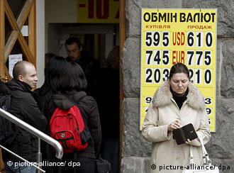Ukrainians queue at a currency exchange office in central Kiev