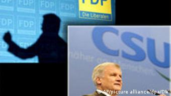 Bavarian leader Seehofer with a shadow of FDP leader Westerwelle