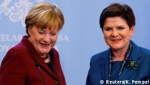 07.02.2017 German Chancellor Angela Merkel and Polish Prime minister Beata Szydlo smile during a press conference in Warsaw, Poland February 7, 2017. REUTERS/Kacper Pempel