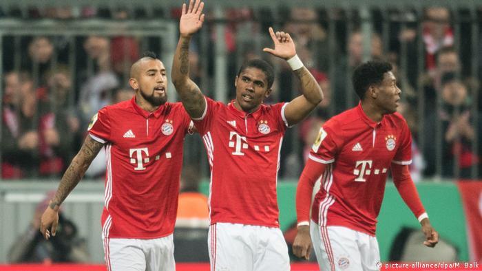 Douglas Costa celebrates a goal