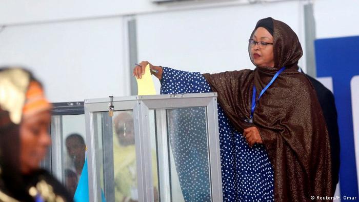 A Somali lawmaker casts her ballot