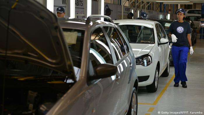 A car technician walks past several volkswagen cars in Thika assembly plant, Kenya. (Getty Images/AFP/T. Karumba)