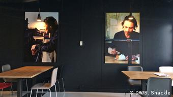 Photographs of previous trainees are displayed in the hotel's communal areas