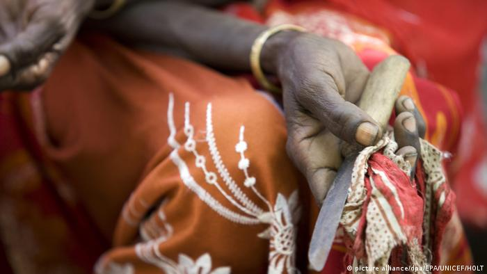 An undated handout picture made available by The United Nations Children's Fund (UNICEF) on 05 February 2016 shows Boko Mohammed, a former excisor, a practitioner who performs female genital mutilation/cutting (FGM/C), holding the tool she used to perform the procedure at a community meeting in Kabele Village, in Amibara District, Afar Region, Ethiopia. (picture alliance/dpa/EPA/UNICEF/HOLT)