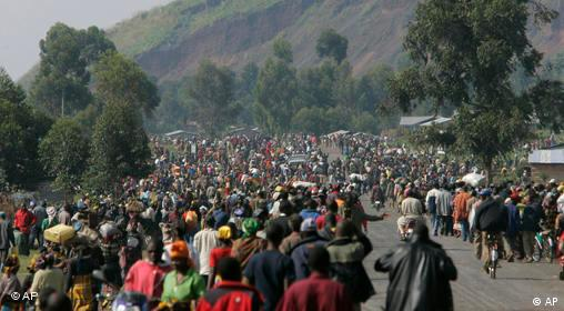 Some of the thousands of displaced people gather in the village of Kibati some 12 kilometers north of Goma in eastern Congo