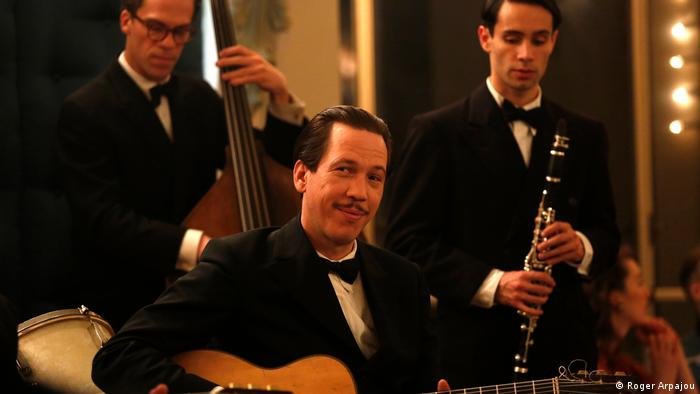 Movie still from Django, showing a three-piece band (c): Roger Arpajou