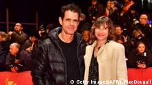 Berlinale | Tom Tykwer with his partner Marie Steinmann (Getty Images/AFP/J. MacDougall)