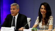 USA George und Amal Clooney