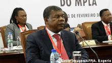 Angolan Defense Minister João Lourenço (L) and the Angolan president attend the ordinary meeting of the central committee of Angolan Ruling party Movement for the Liberation of Angola (MPLA) to decide on the candidates list for the upcoming presidential elections on February 3, 2017 in Luanda. Angolan President Jose Eduardo dos Santos's announcement that he will step down bringing to an end a 37-year reign marked by an unrelenting authoritarian style. Though seldom seen in public, he has been a looming presence in daily life for as long as most Angolans can remember, maintaining fierce control over the country throughout its devastating civil war and recent oil boom. Now aged 74, and in reportedly poor health, Dos Santos became president in 1979, making him Africa's second-longest serving leader -- one month shy of Equatorial Guinea's Teodoro Obiang Nguema. Joao Lourenco, Dos Santos's defence minister, was named as the ruling party's candidate to run in the president's place in August elections. / AFP / AMPE ROGERIO (Photo credit should read AMPE ROGERIO/AFP/Getty Images)