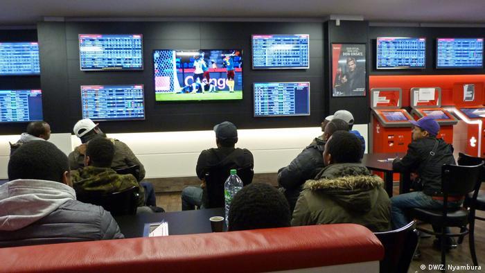 African footbal fans watching a match in Bonn.