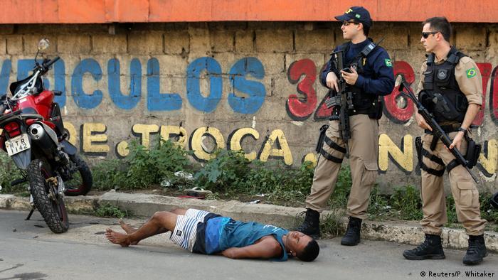 Brazilian soldiers detain a suspected criminal