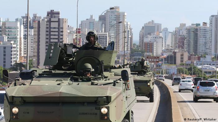 Brazilian Marines patrol a street in Vitoria, Espirito Santo