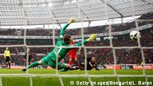 LEVERKUSEN, GERMANY - FEBRUARY 11: Chicharito of Bayer Leverkusen scores his teams first goal during the Bundesliga match between Bayer 04 Leverkusen and Eintracht Frankfurt at BayArena on February 11, 2017 in Leverkusen, Germany. (Photo by Lars Baron/Bongarts/Getty Images)