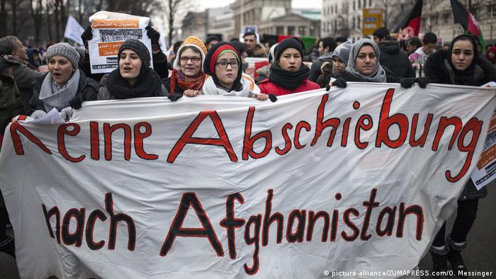 fghan Nationals marched along side locals in the streets of Berlin, protesting recent decision by the German federal government to deport Afghan nationals who's asylum requests have been rejected back to their home country