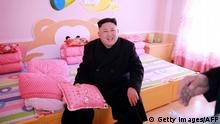 This undated picture released by North Korean news agency, KCNA (Korean Central News Agency) on February 2, 2017 shows North Korean leader Kim Jong-Un visiting newly built Pyongyang Orphans' Primary School. REPUBLIC OF KOREA OUT ---EDITORS NOTE--- RESTRICTED TO EDITORIAL USE - MANDATORY CREDIT AFP PHOTO / KCNA VIA KNS - NO MARKETING NO ADVERTISING CAMPAIGNS - DISTRIBUTED AS A SERVICE TO CLIENTS / AFP / KCNA VIA KNS / STR (Photo credit should read STR/AFP/Getty Images)