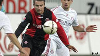 Frankfurt's Nikos Liberopoulus, left, and Munich's Franck Ribery fight for the ball during a German first division soccer match between Eintracht Frankfurt and Bayern Munich in Frankfurt on Oct. 29