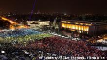 12.02.2017 Protesters display the Romanian national flag colours during a demonstration in front of the government building in Bucharest, Romania, February 12, 2017. Inquam Photos/Liviu Florin Albei via REUTERS ATTENTION EDITORS - THIS IMAGE WAS PROVIDED BY A THIRD PARTY. EDITORIAL USE ONLY. ROMANIA OUT. NO COMMERCIAL OR EDITORIAL SALES IN ROMANIA.