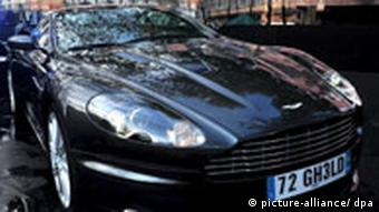 The official 'Bond car', an Aston Martin DBS, is exhibited in front of the cinema before the world premiere of film director Marc Forster's film 'Quantum of Solace' held at the Odeon Leicester Square in Central London, Britain, 29 October 2008. The film is the twenty-second part in the James Bond franchise and tells the story of British secret agent 007, who is on a mission to stop a powerful illegal cartell from taking over some of the world's most precious natural resources. Release date in the UK is 31 October 2008. EPA/DANIEL DEME +++(c) dpa - Report+++