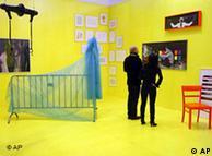 Visitors look at artworks at Berlin's Art Forum fair