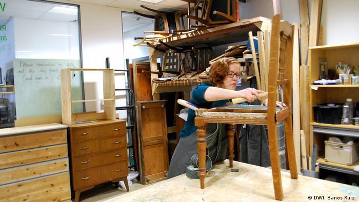 A member of the Edinburgh Remakery's team repairs a chair