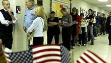 Early voters wait on line for the polls to open at Whetstone Recreation Center Tuesday, Nov. 2, 2004 in Columbus, Ohio. (AP Photo/Jay LaPrete)