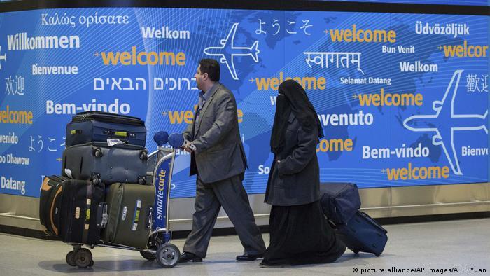 Muslim passengers disembark at JFK airport