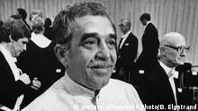 """FILE - In this Dec. 8, 1982 file photo, Gabriel Garcia Marquez shows his Nobel Prize for literature medal after his Nobel Lecture in Stockholm, Sweden. The Swedish Academy praised Marquez for his novels and short stories, in which the fantastic and the realistic are combined in a richly composed world of imagination, reflecting a continent's life and conflicts. Garcia Marquez is widely seen as the Spanish language's most-popular 20th century writer through novels such as 1967's """"One Hundred Years of Solitude. This year's winner is due to be announced on Thursday, Oct. 13, 2016. (AP Photo/Bjorn Elgstrand, Pool, File)  """