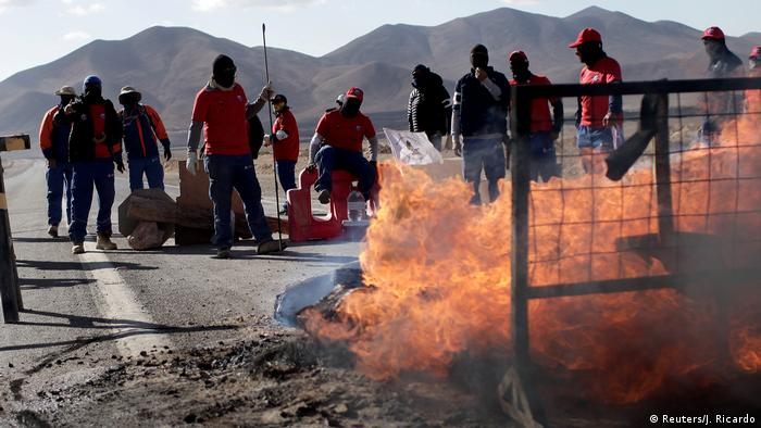 Workers from BHP Billiton's Escondida, the world's biggest copper mine, gather outside the company gates during a strike