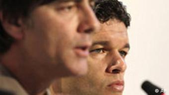 Close-up of Joachim Loew and Michael Ballack at a press conference